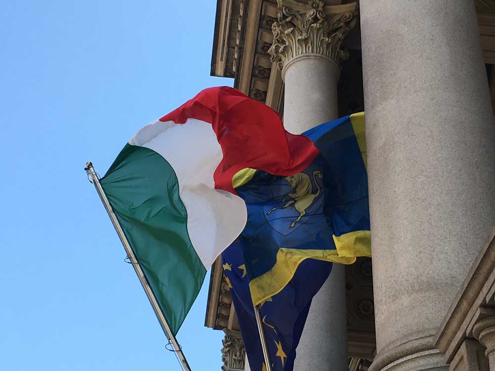 flags of italy and turin flying from museum of cinema