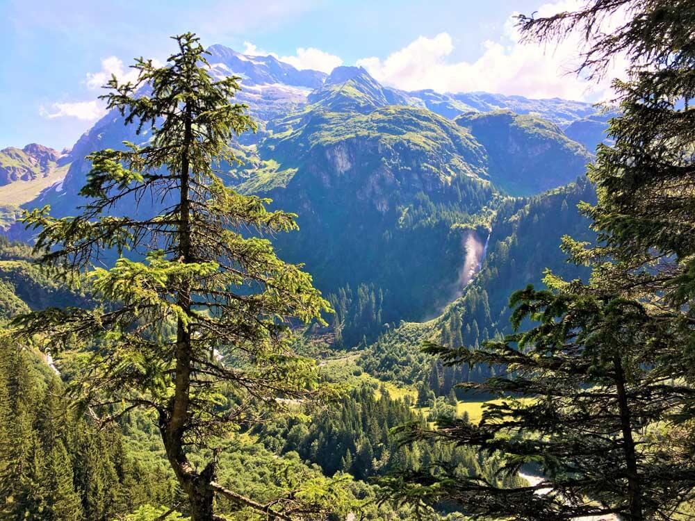 waterfall cascading down mountain in Switzerland