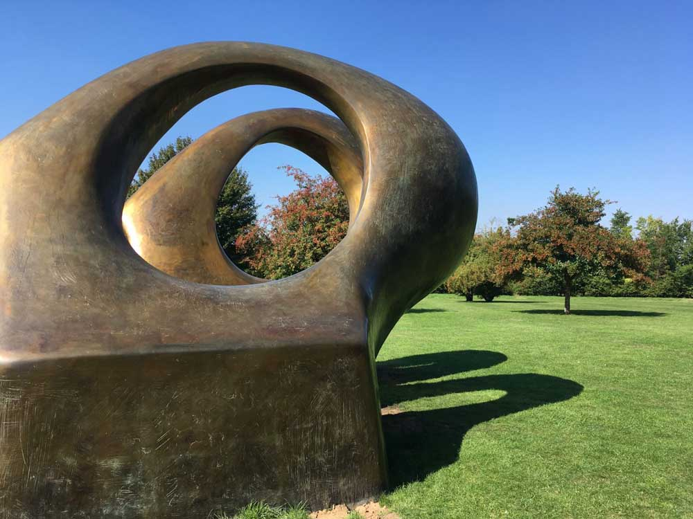 abstract bronze sculpture on lawn, Henry Moore Studios and Gardens in Hertfordshire: one of the best sculpture parks in the UK