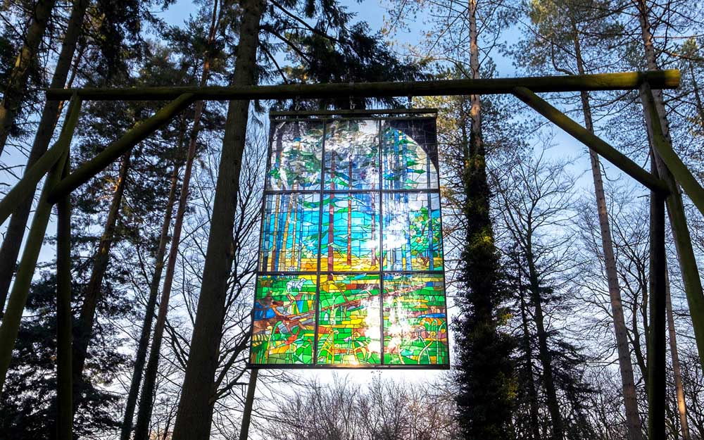 stained glass window in forest Forest of Dean Sculpture Trail in Gloucestershire