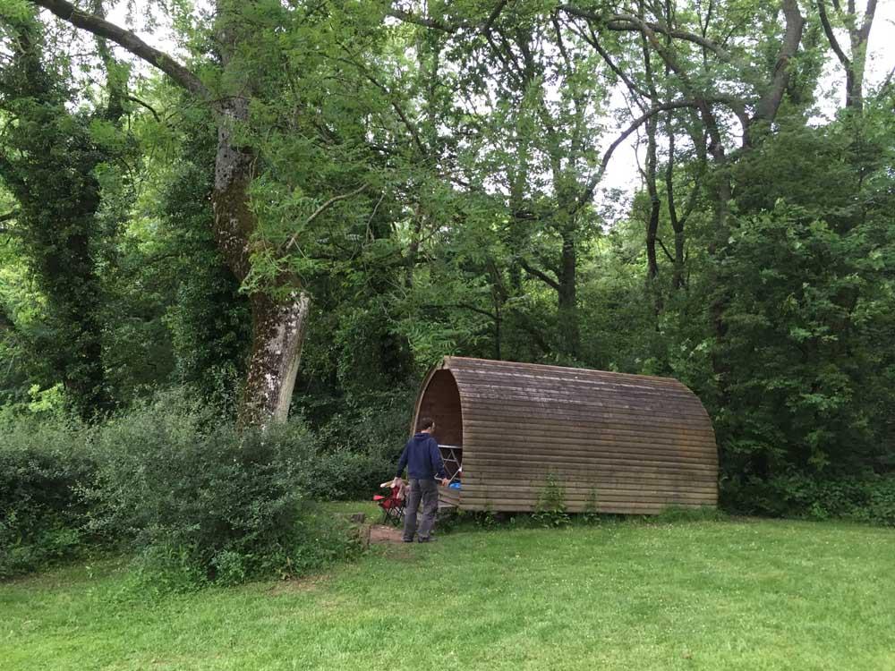 wooden pod in farm field, Wiltshire