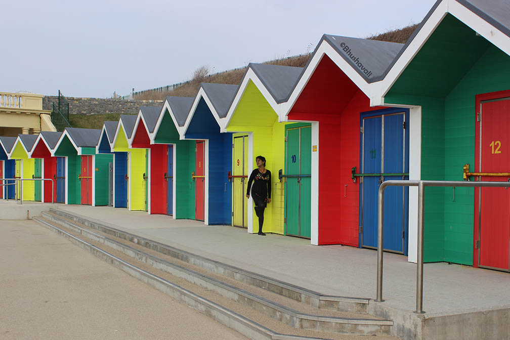 colourful beach huts in Wales