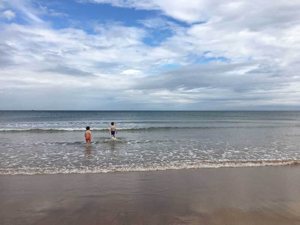 Children playing in the sea Northern Ireland