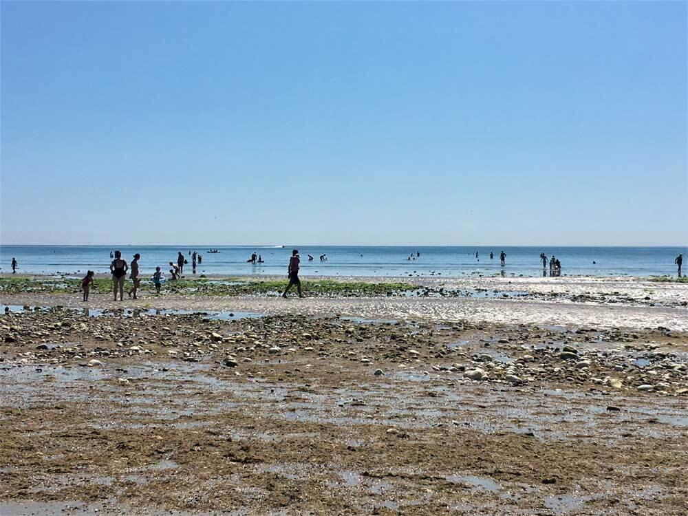 people enjoying a UK seaside holiday