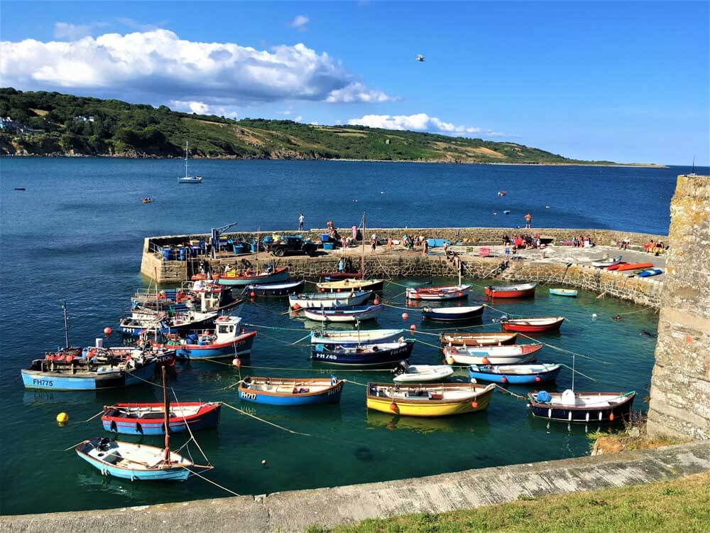 colourful fishing boats in cornish harbour