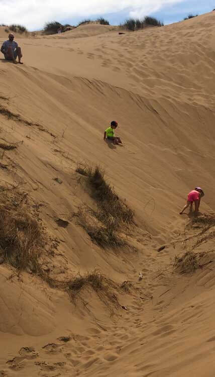Children playing on sand dunes at Formby Beach