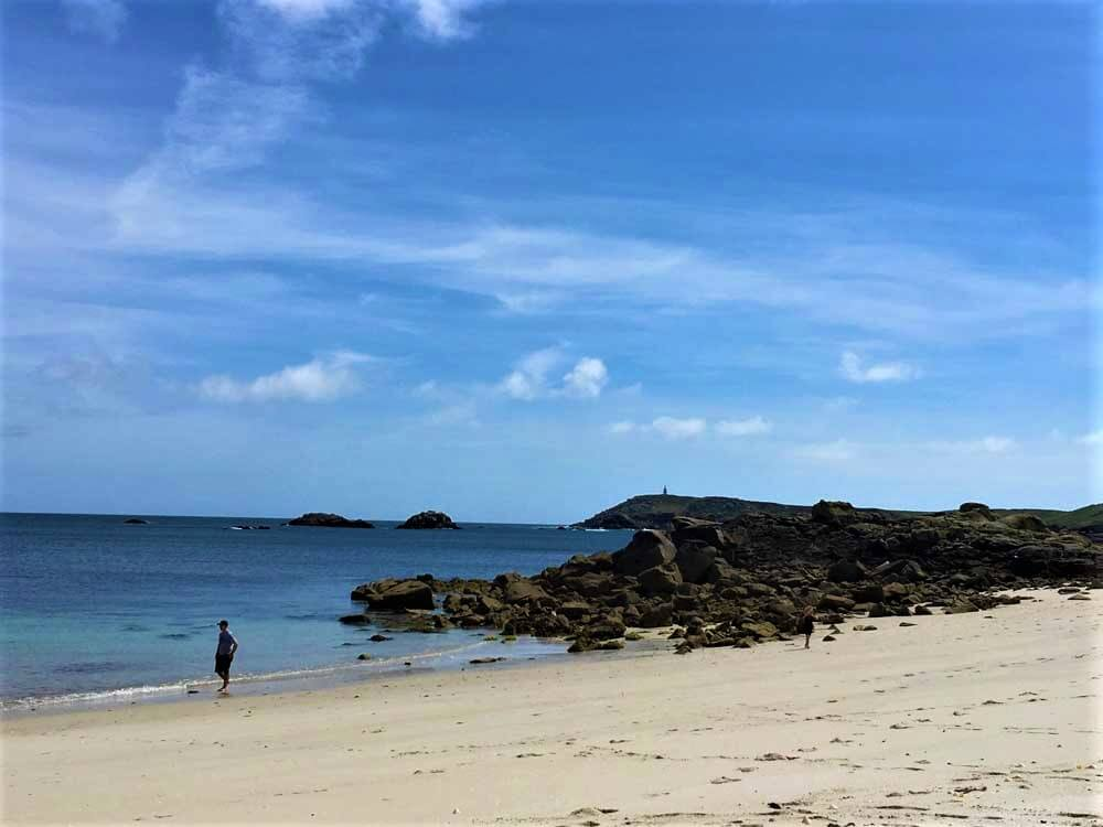 Lone figure on the beach at Great Bay St martin's Isles of Scilly