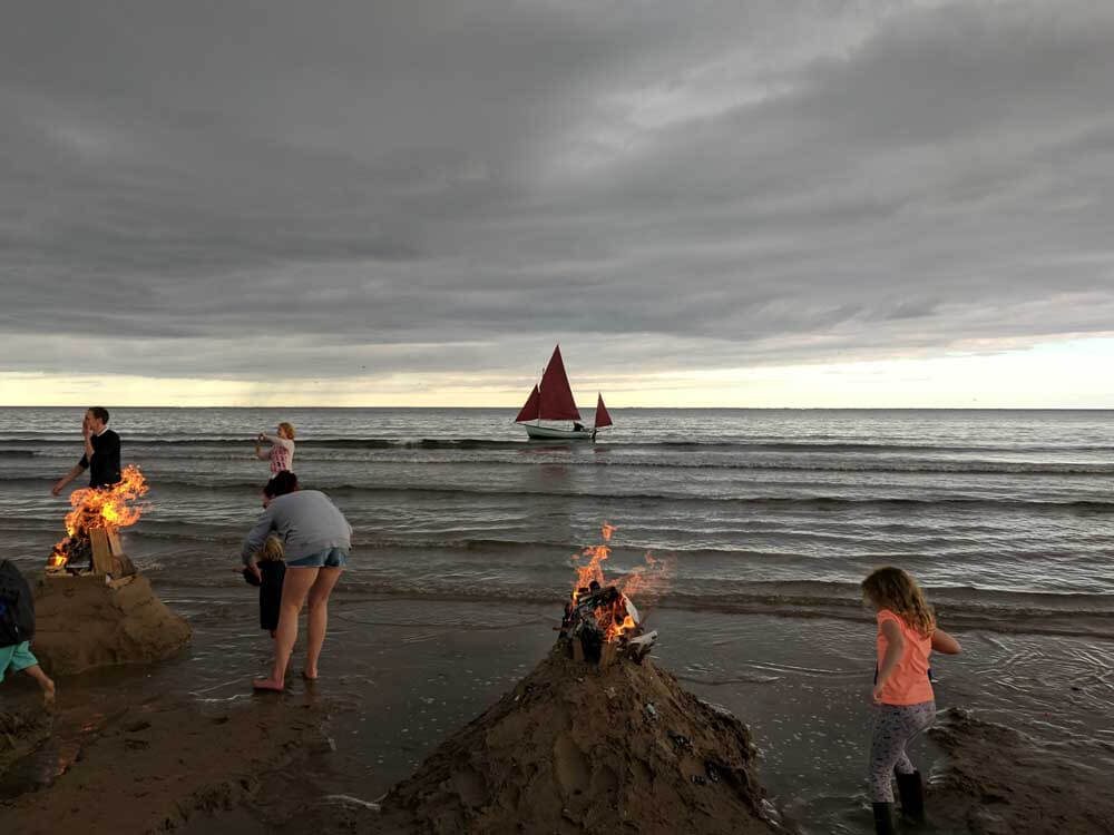 Children building castles on the beach at Alnmouth Northumberland
