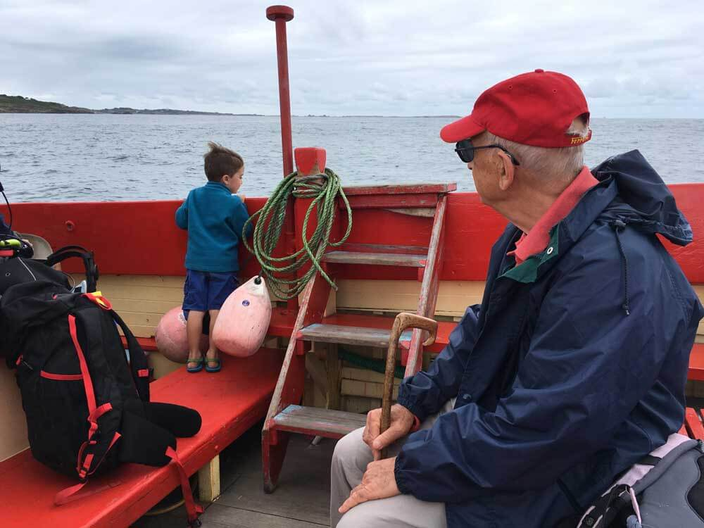 family on boat trip in the scilly isles