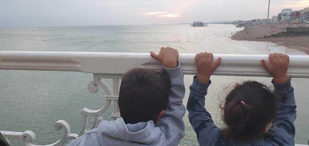 Children looking towards Brighton west pier