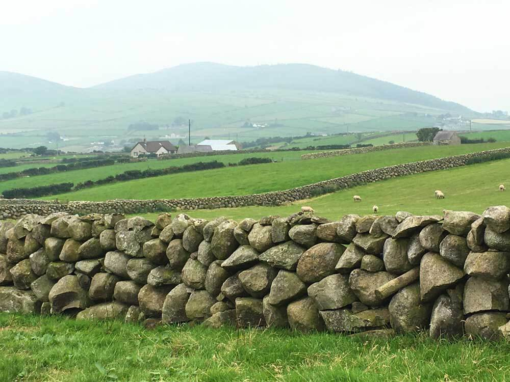 Dry stone wall with mountain in background