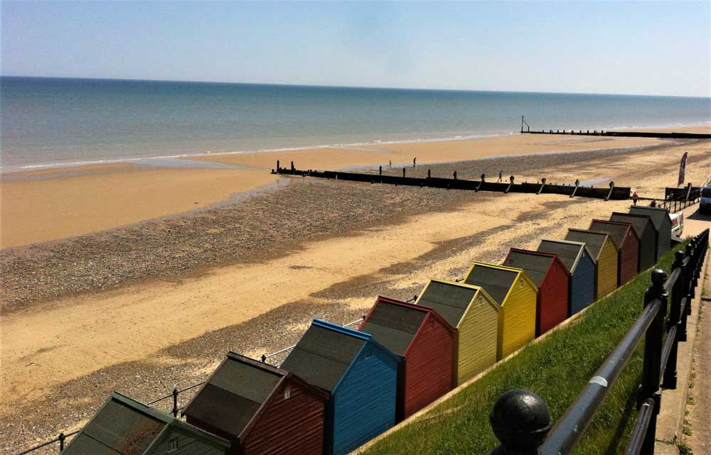colourful beach huts for a uk beach break in Mundesley