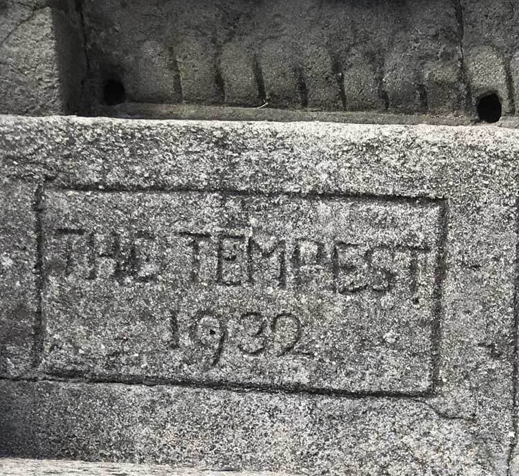 Performance names and dates hand carved into the concrete seats at the Minack Theatre