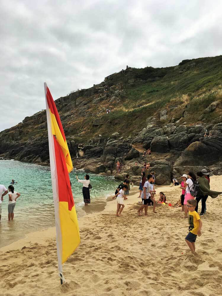 Porthcurno Beach with the steep climb from the Minack Theatre in the background