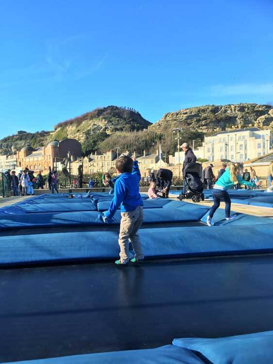 child jumping on trampoline in hastings east sussex