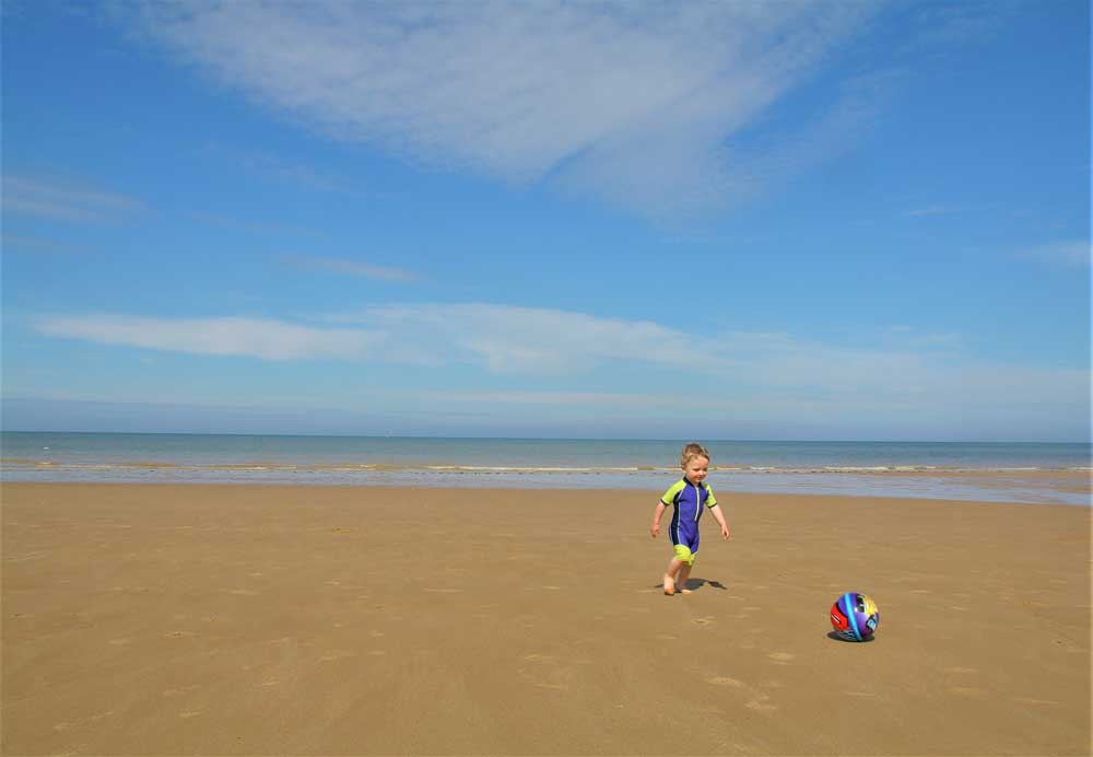 boy on beach with football
