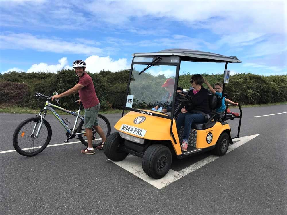 golf buggy and bike on a road on the island of St mary Scilly Isles