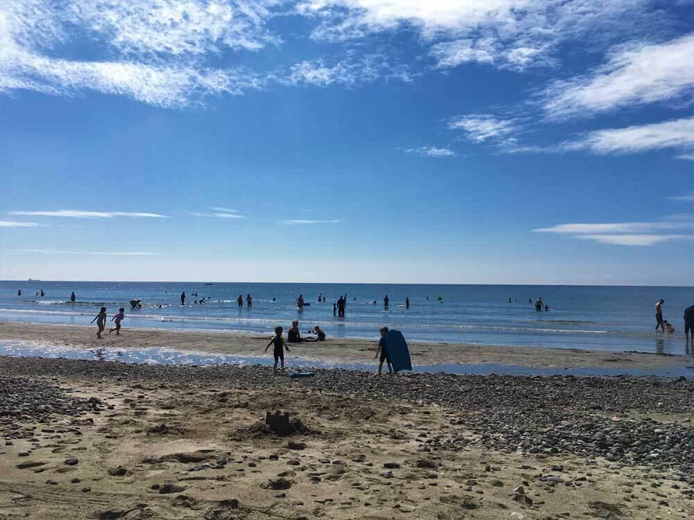 people enjoying the beach at Kennack Sands in Cornwall