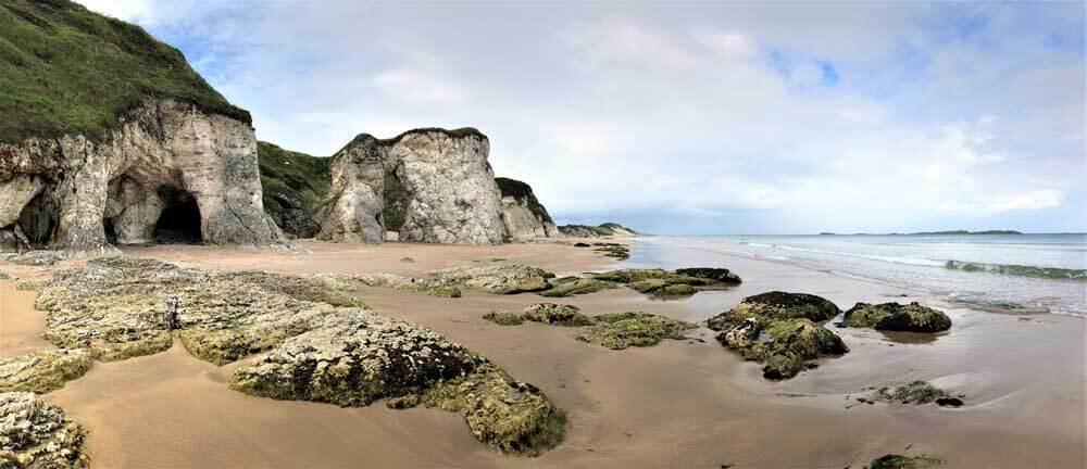 rock arches on sandy beach in Northern Ireland
