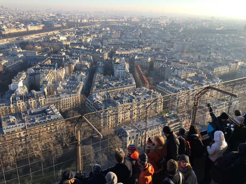 Crowds look out from the Eiffel Tower in Paris
