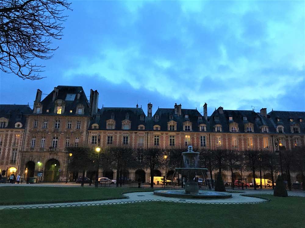 Evening in Place des Vosges in Paris
