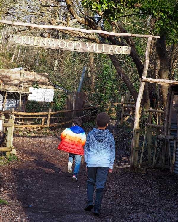 Children running into Amberley Open air Museum UK