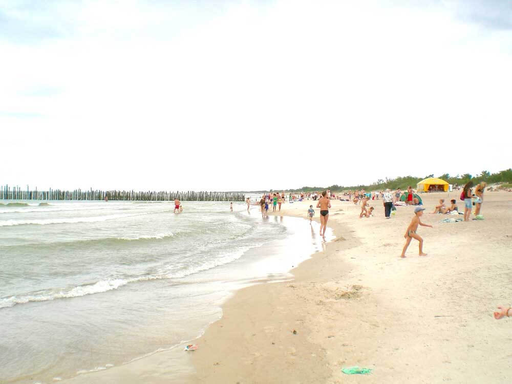 People on the beach at Šventoji in Lithuania