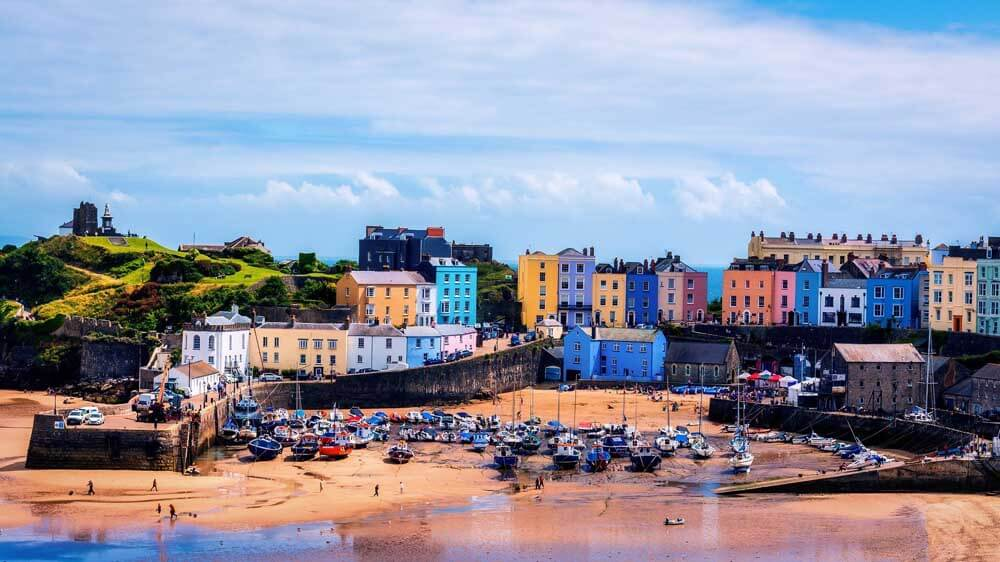 Colourful buildings in Tenby overlooking the beach in Wales