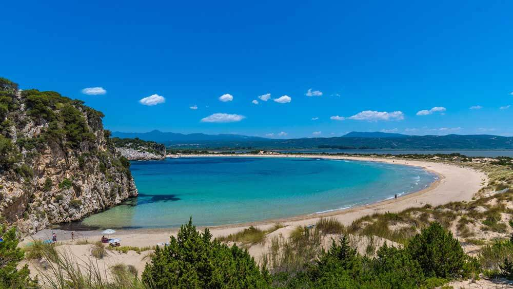 arc of sandy beach with turquoise sea in the Peloponnese Greece