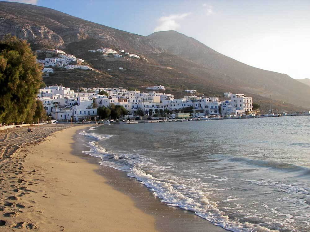 Sandy beach with white washed houses in background