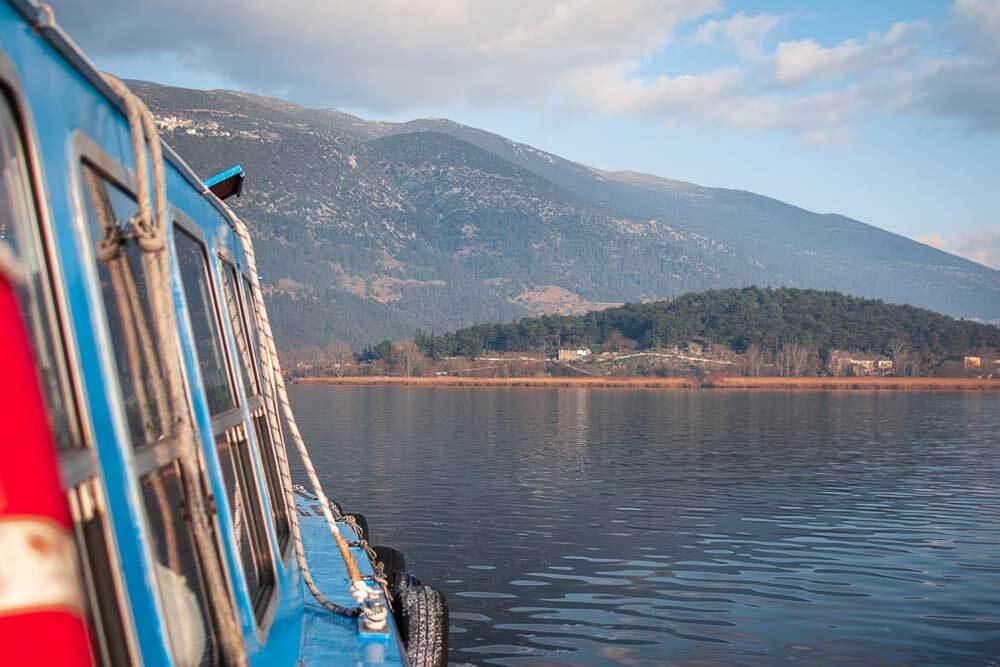 Boat heading towards shore of Lake Pamvotida