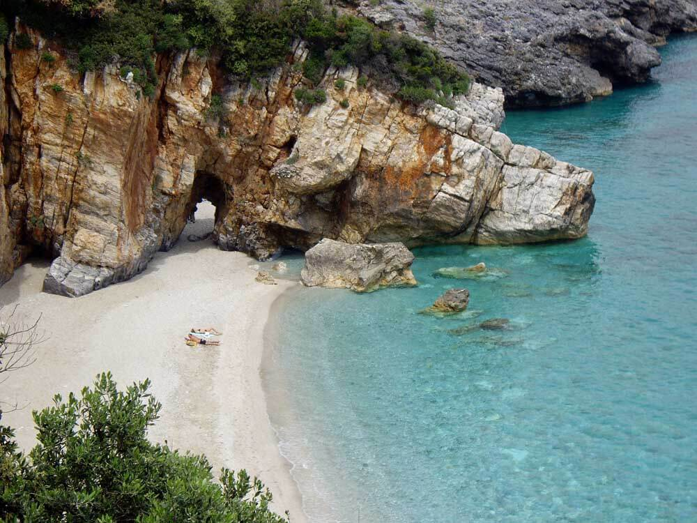 beach with rock arch in the Pelion, one of the best places in Greece for families