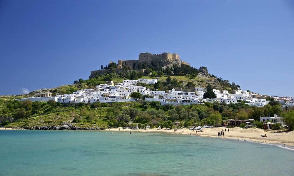 castle on hilltop with sea beneath in Rhodes, one of the best places in Greece for families