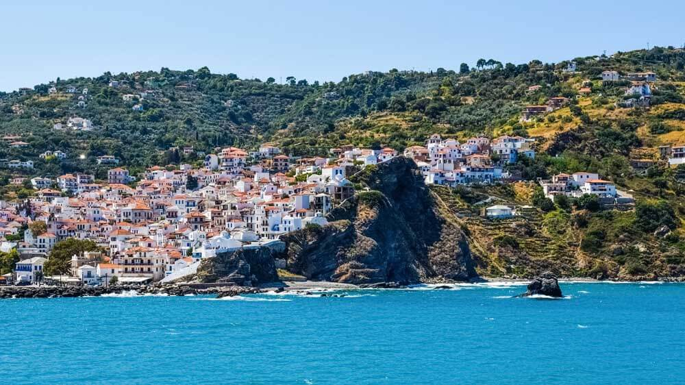 Whitewashed houses on hillside in Skopelos