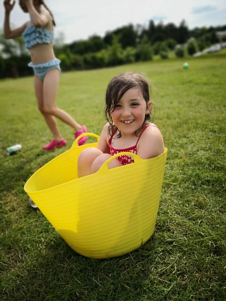 child in a yellow bucket