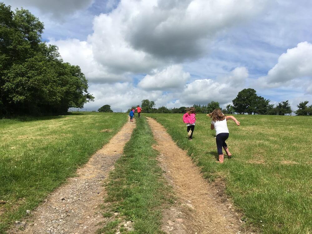 Children running along farm track