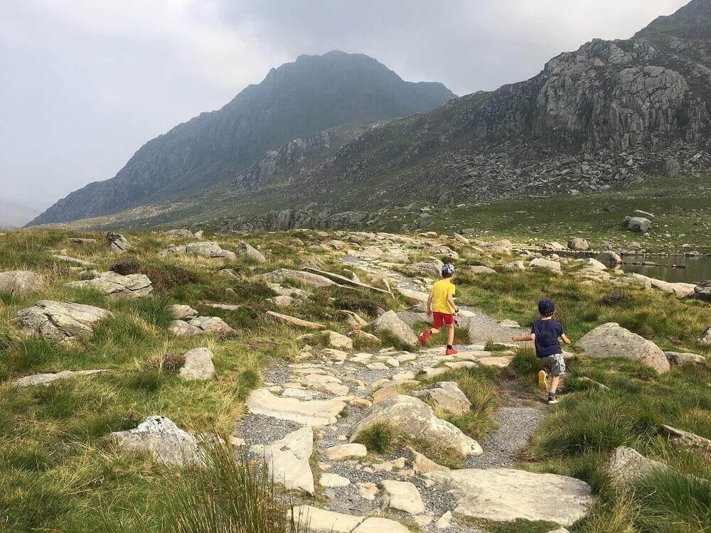children running along stone path in Wales