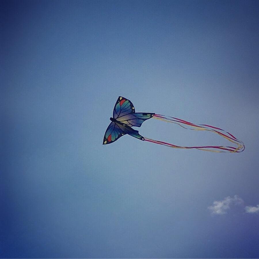 butterfly kite against blue sky