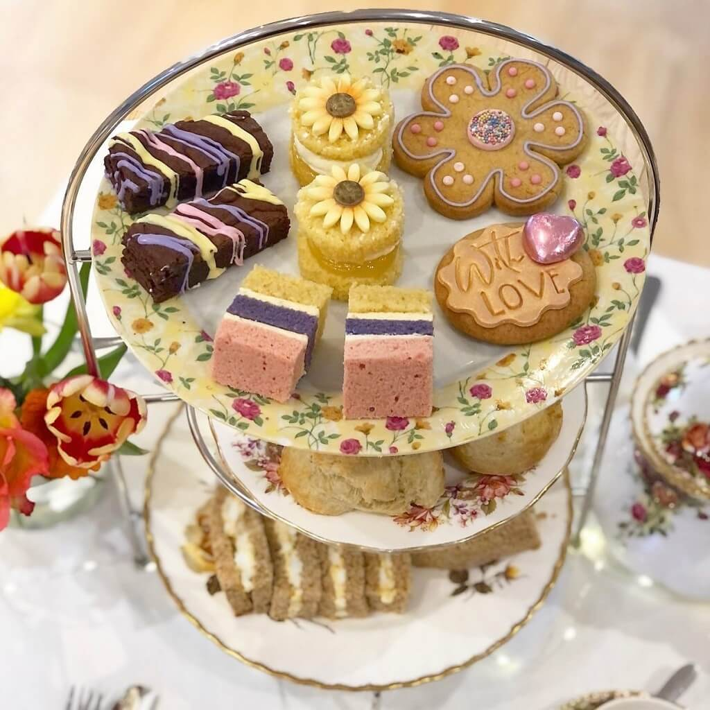 Afternoon tea stand with cakes and sandwiches
