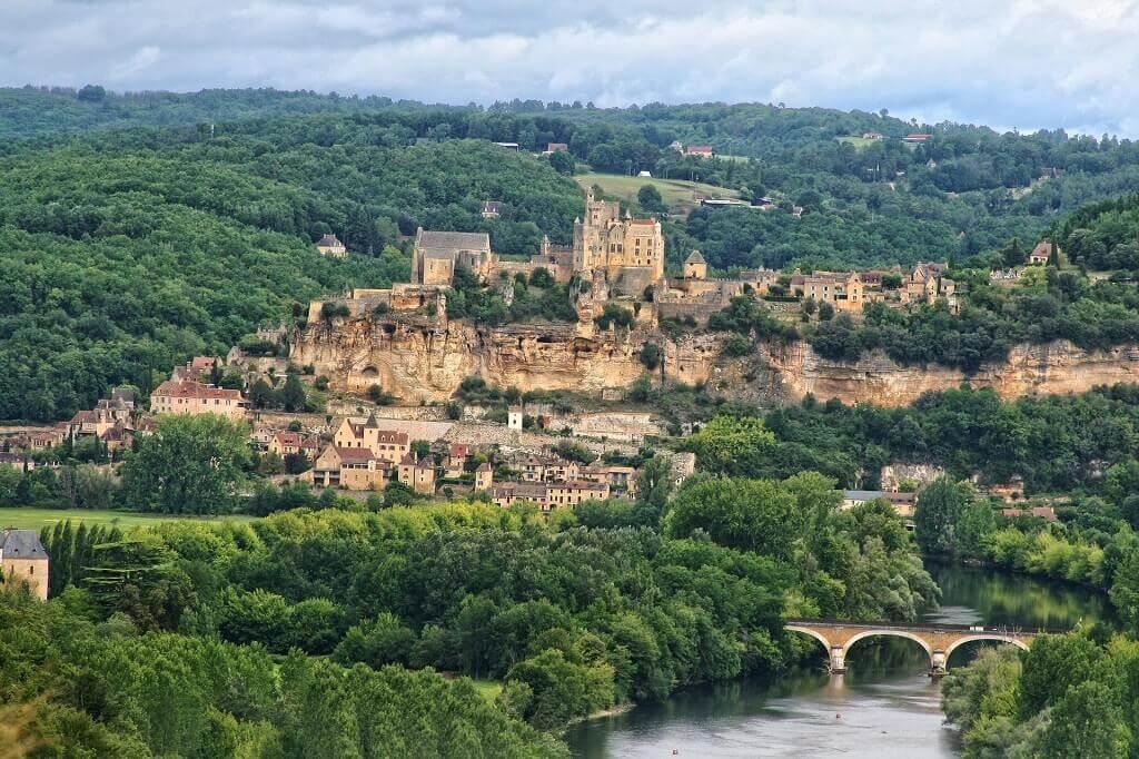 Medieval village overlooking river in France