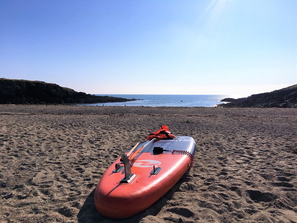 Paddleboard on beach in Anglesey North Wales