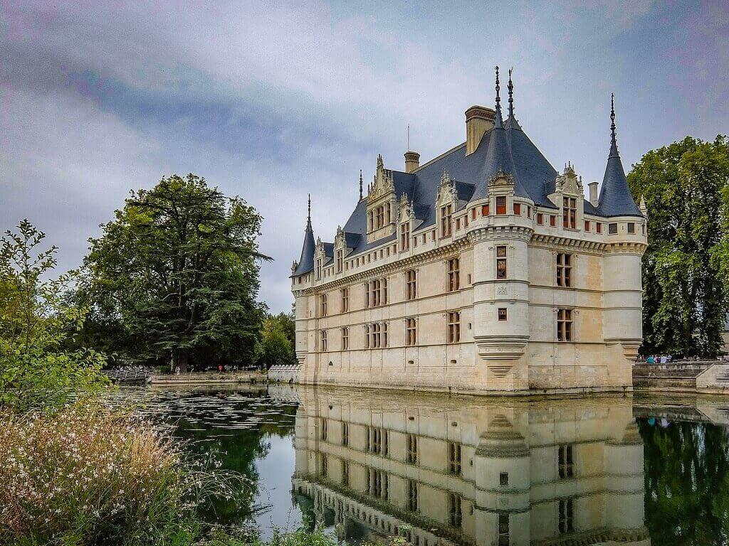 Chateau with reflection in water in Loire, France family holiday